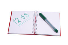 Notebook with written numbers and green felt-tip pen. Royalty Free Stock Images