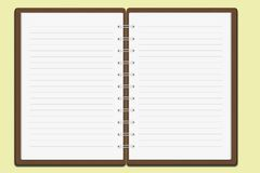 Notebook on yellow background Royalty Free Stock Photography