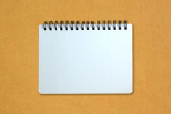 Notebook on yellow cardboard paper Royalty Free Stock Photos