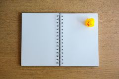 Notebook and yellow duck on wood desk. 2 pages of notebook and yellow duck on wood desk stock photos