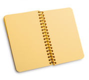 Notebook with yellow pages on a spira with shadow Stock Photo