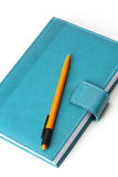 Notebook  with yellow pen Stock Photo