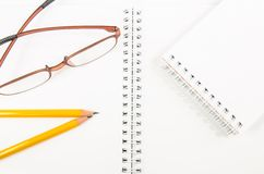 Notebook and yellow pencil and eyeglass Stock Photo