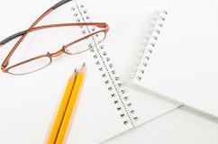Notebook and yellow pencil and eyeglass Stock Photography