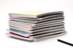 Notebooks. A pile of notebooks with pen Royalty Free Stock Photos