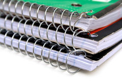 Notebooks. A stack of three ringed spiral notebooks Royalty Free Stock Image