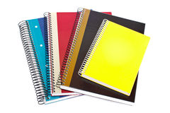 Notebooks. Some notebooks isolated on white background. Shallow depth of field stock photo