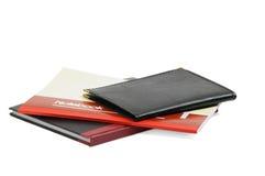 Notebooks. Assorted notebooks flat piled on white background Royalty Free Stock Photos