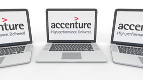Notebooks with Accenture logo on the screen. Computer technology conceptual editorial 3D rendering Royalty Free Stock Photography