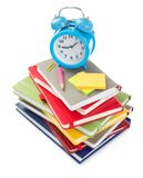 Notebooks and alarm clock at white background stock photo