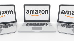 Notebooks with Amazon.com logo on the screen. Computer technology conceptual editorial 3D rendering. Notebooks with Amazon.com logo on the screen. Computer Royalty Free Stock Images