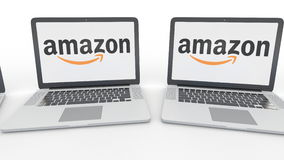 Notebooks with Amazon.com logo on the screen. Computer technology conceptual editorial 4K clip, seamless loop. Notebooks with Amazon.com logo on the screen stock video