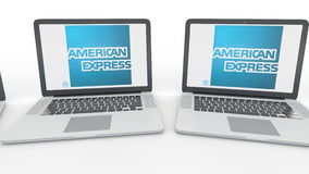 Notebooks with American Express logo on the screen. Computer technology conceptual editorial 4K clip, seamless loop. Notebooks with American Express logo on the stock footage