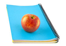 Notebooks and apple Stock Image