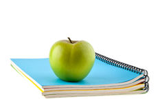 Notebooks and apple Royalty Free Stock Photography