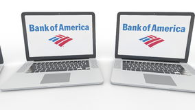 Notebooks with Bank of America logo on the screen. Computer technology conceptual editorial 4K clip, seamless loop