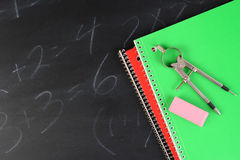Notebooks on Blackboard Royalty Free Stock Images