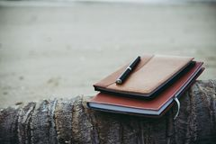 Free Notebooks,books And Pen On The Beach. Royalty Free Stock Photo - 113736215
