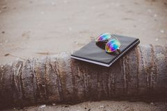 Notebooks,books and glasses on the beach.  Stock Images