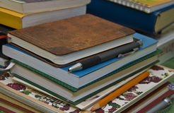 Notebooks, books and pencils stock images