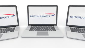 Notebooks with British Airways logo on the screen. Computer technology conceptual editorial 3D rendering. Notebooks with British Airways logo on the screen stock illustration