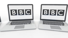 Notebooks with British Broadcasting Corporation BBC logo on the screen. Computer technology conceptual editorial 4K clip. Notebooks with British Broadcasting vector illustration