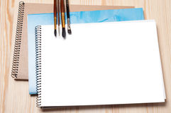 Notebooks and brushes Royalty Free Stock Photos