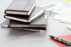Notebooks and business card. Stack of notebooks and business card Stock Image