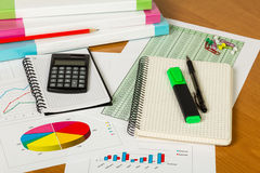 Notebooks, calculator and other office supplies on desktop background. Stock Photos