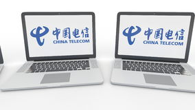 Notebooks with China Telecom logo on the screen. Computer technology conceptual editorial 4K clip, seamless loop stock footage