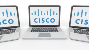 Notebooks with Cisco Systems logo on the screen. Computer technology conceptual editorial 3D rendering Royalty Free Stock Photo