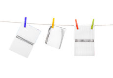 Notebooks on clothespins Royalty Free Stock Images