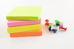 Notebooks and colored paper clips Stock Images