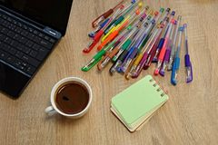 Notebooks, colored pens Stock Photo