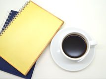 Notebooks and a cup of coffee Royalty Free Stock Images