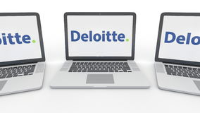 Notebooks with Deloitte logo on the screen. Computer technology conceptual editorial 3D rendering. Notebooks with Deloitte logo on the screen. Computer Stock Photography