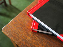 Notebooks on desk. Closeup of two notebooks placed at the corner of a desk in classroom of high school Stock Photo