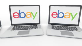 Notebooks with eBay Inc. logo on the screen. Computer technology conceptual editorial 4K clip, seamless loop. Notebooks with eBay Inc. logo on the screen stock video