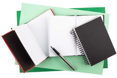 Notebooks and a fountain pen on textured paper Royalty Free Stock Image