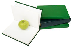 Notebooks with green apple Royalty Free Stock Photo
