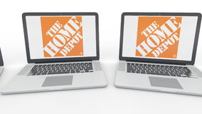 Notebooks with The Home Depot logo on the screen. Computer technology conceptual editorial 4K clip, seamless loop. Notebooks with The Home Depot logo on the stock video