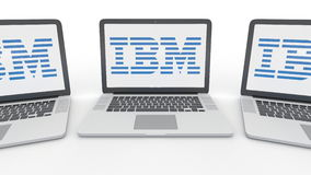 Notebooks with IBM logo on the screen. Computer technology conceptual editorial 3D rendering. Notebooks with IBM logo on the screen. Computer technology Stock Photography