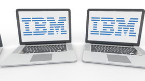Notebooks with IBM logo on the screen. Computer technology conceptual editorial 4K clip, seamless loop. Notebooks with IBM logo on the screen. Computer stock video