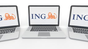 Notebooks with ING Group logo on the screen. Computer technology conceptual editorial 3D rendering Stock Images