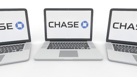 Notebooks with JPMorgan Chase Bank logo on the screen. Computer technology conceptual editorial 3D rendering Royalty Free Stock Images