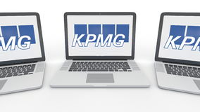 Notebooks with KPMG logo on the screen. Computer technology conceptual editorial 3D rendering. Notebooks with KPMG logo on the screen. Computer technology Stock Image