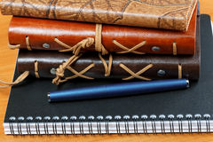 Notebooks with leather cover and pen Stock Photos