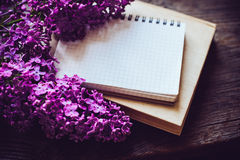 Notebooks, and lilac flowers Royalty Free Stock Image