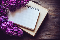 Notebooks, and lilac flowers Stock Images