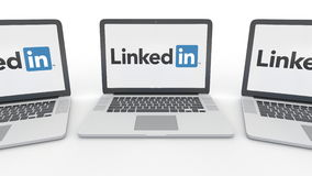 Notebooks with LinkedIn logo on the screen. Computer technology conceptual editorial 3D rendering Royalty Free Stock Photos